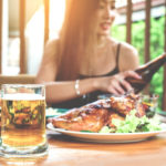 woman dines outside during summer