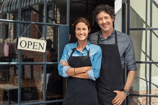 couple standing in restaurant doorway
